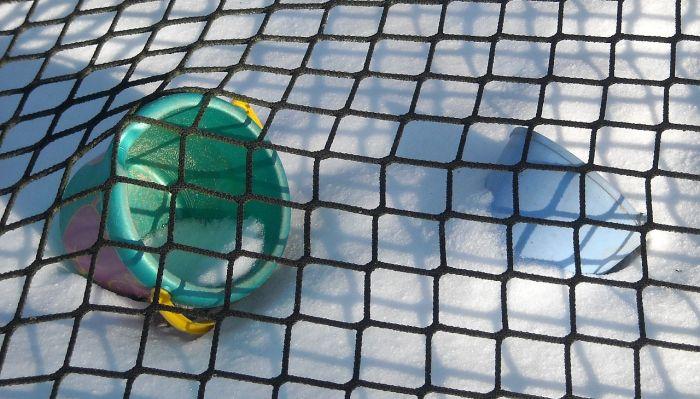 Netz als Sandkastenabdeckung